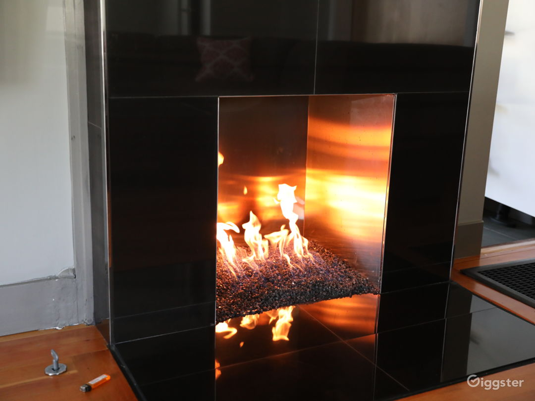 living room fireplace with fire glass and stainless steel inner