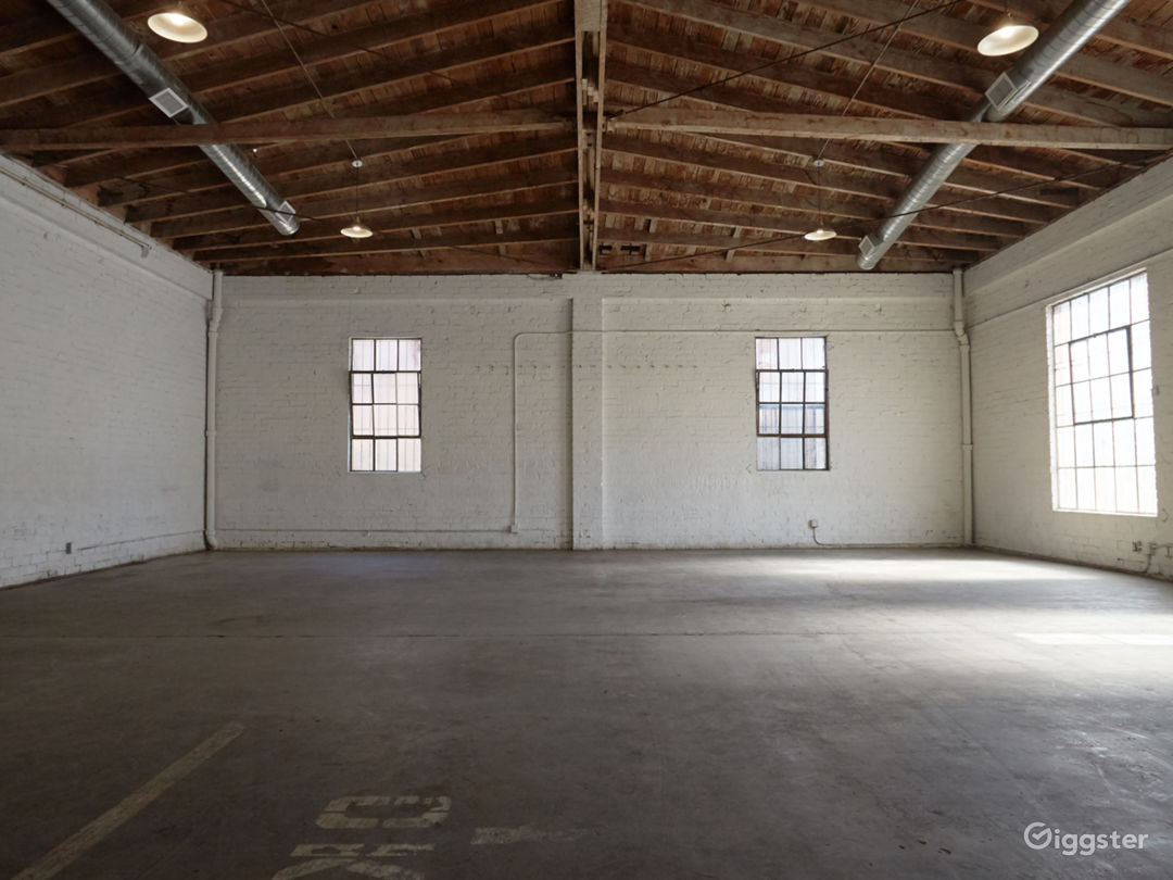 Downtown Brick Warehouse with Bowed Wooden Beams Photo 4