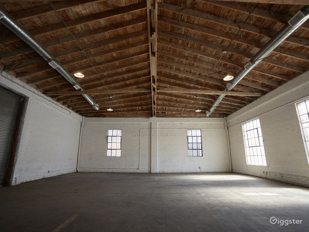 Downtown Brick Warehouse with Bowed Wooden Beams Photo 1