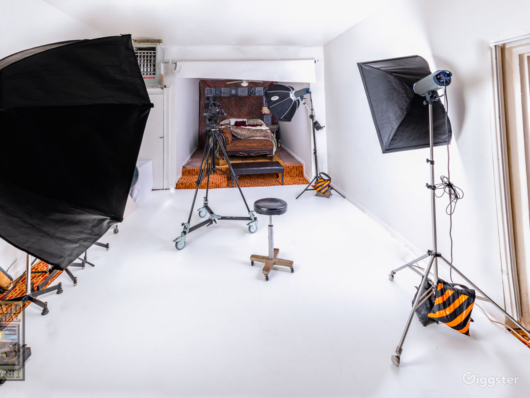 """Main studio area with 107"""" background paper rolled up."""