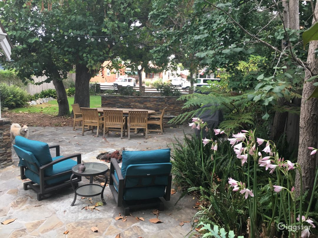 Patio dining and fire pit are set back from the street for privacy.