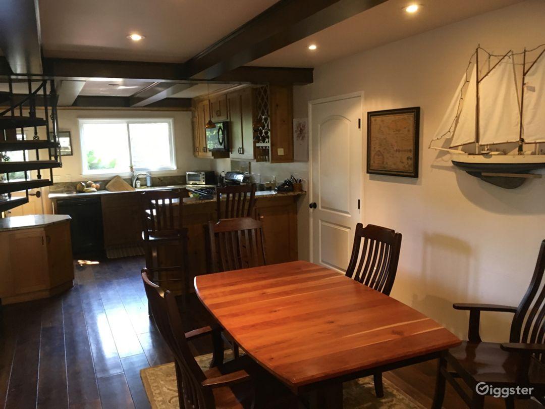 Hardwood floors, spiral staircase and open floor plan.