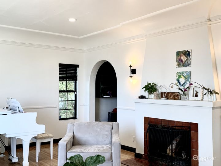Living room fireplace and grand piano