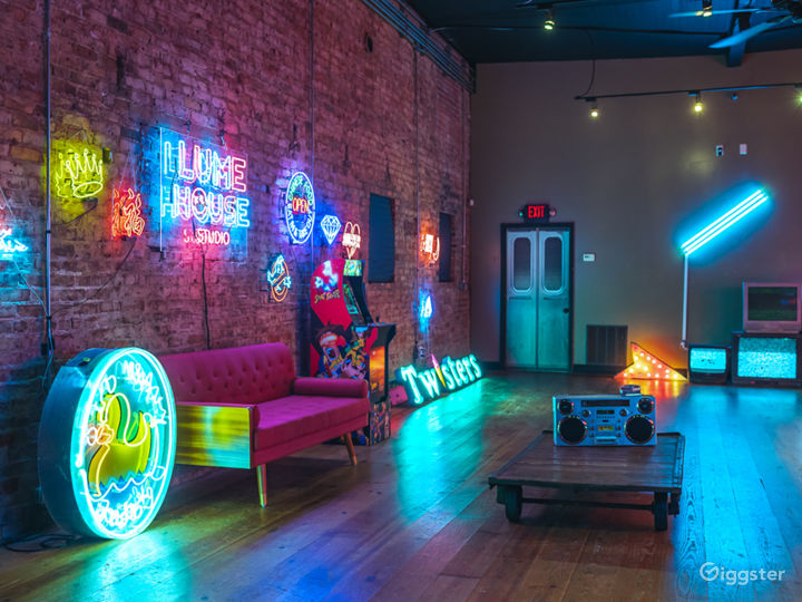 Spacious Studio Space Filled with Neon Photo 2