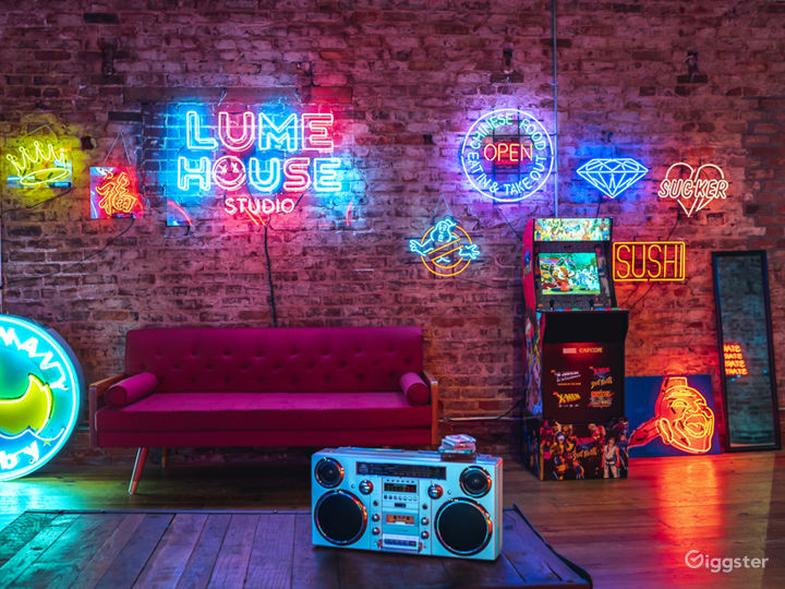 Spacious Studio Space Filled with Neon Photo 5