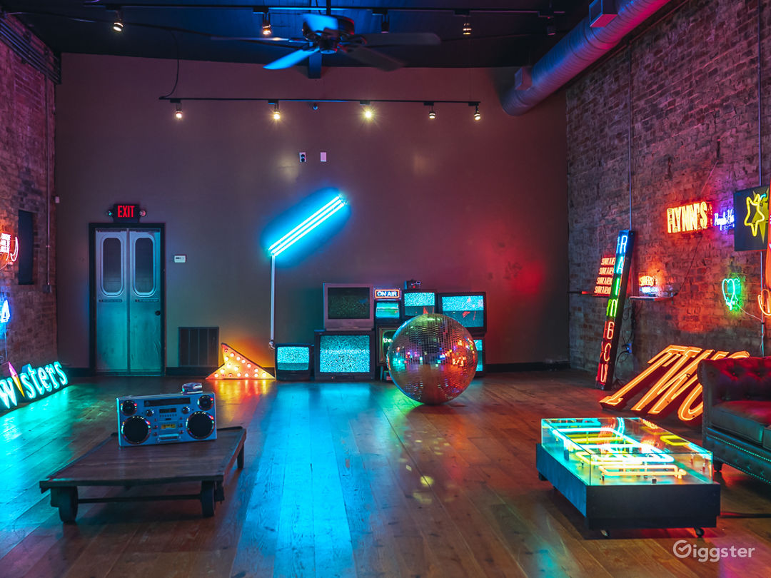 Spacious Studio Space Filled with Neon Photo 1