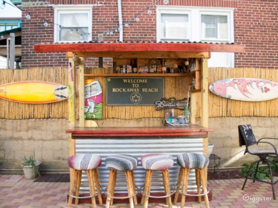 Surfer House With Backyard Bar and Patio Photo 1