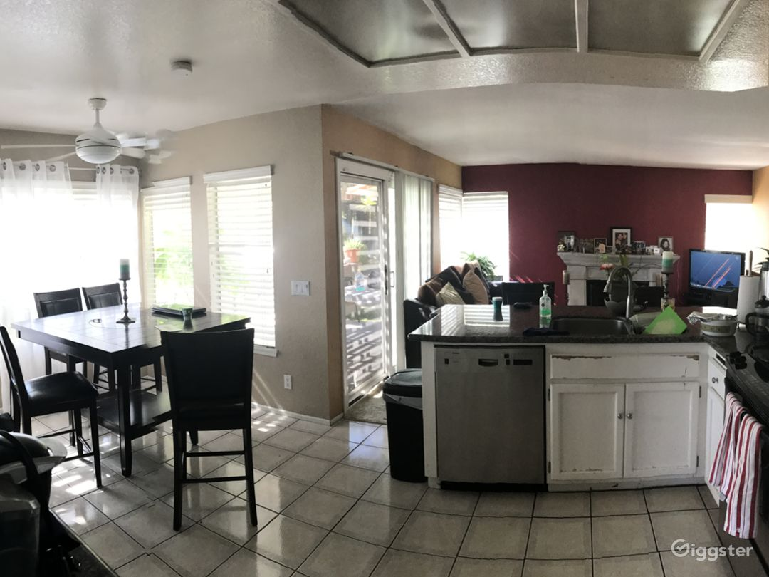 Open kitchen painted in offwhite with dining area and counter.