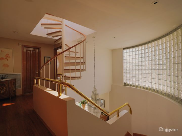 The gold railng on the spiral staircase.