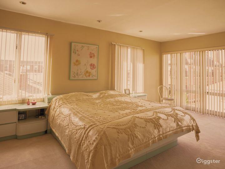 Custom pastel 80s 90s vintage furniture, blinds, and carpeting.