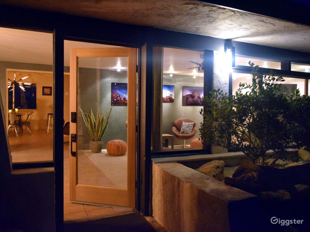 Front door opens to art gallery featuring the night sky of Joshua Tree.