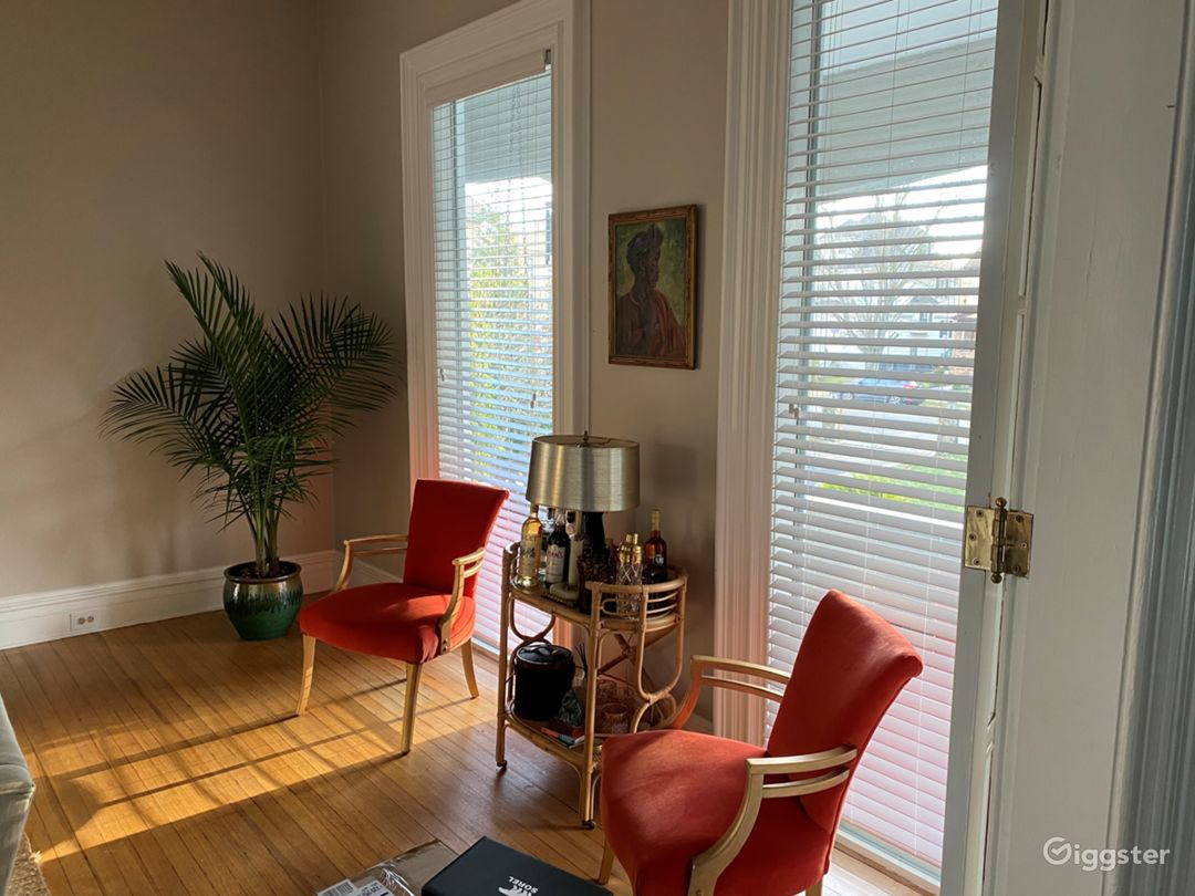 Floor to ceiling windows in living room.