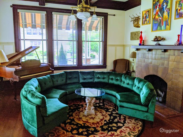 Music room, featuring a working, 1920's baby grand piano and gas log fireplace.