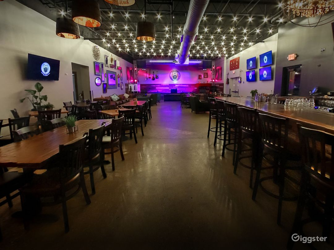 Indoor Dining Space with Bar and Music Stage Photo 1