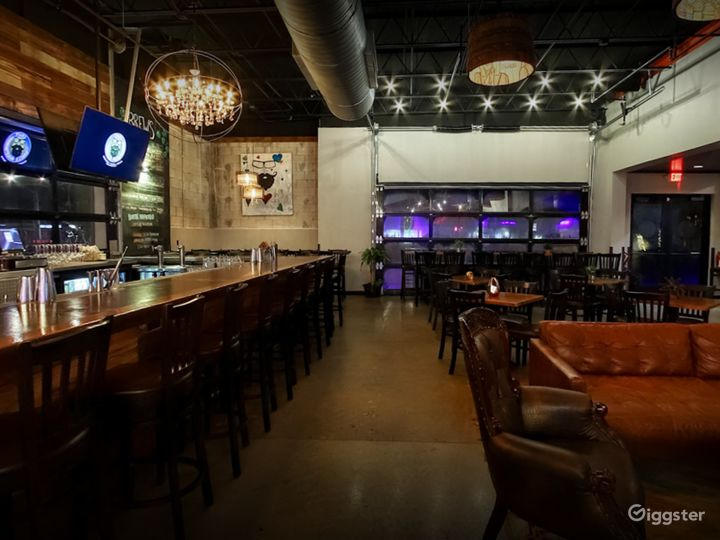Indoor Dining Space with Bar and Music Stage Photo 3