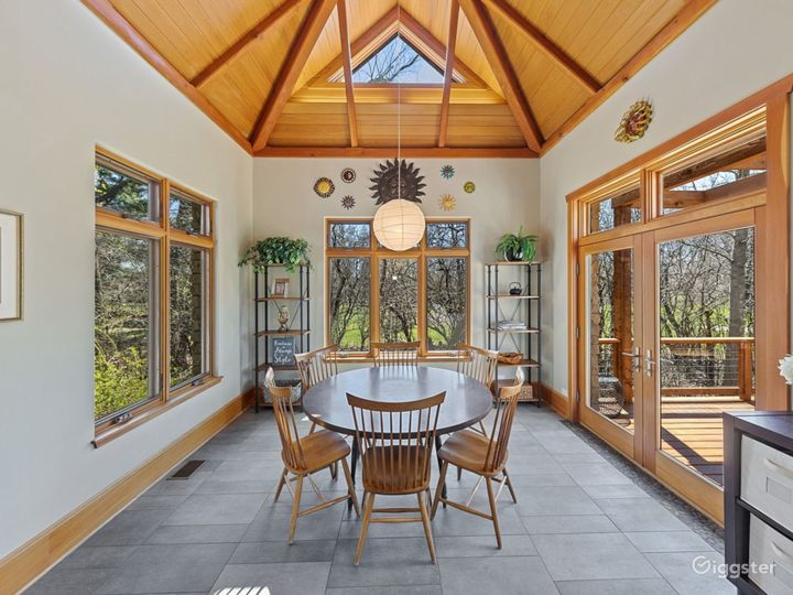 Sunny Breakfast Room with south, east and west exposures, vaulted ceiling, access to deck and vaulted ceiling.