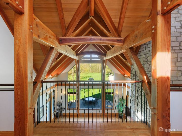 Custom heavy timber frame structure soars to 20+ feet.  This hand cut, true timber exposed structure consists of Douglas Fir beams, Ash pegs and Cherry wood splines and Taiko Beams which connect the major purlins.  Clear Cypress ceiling decking.