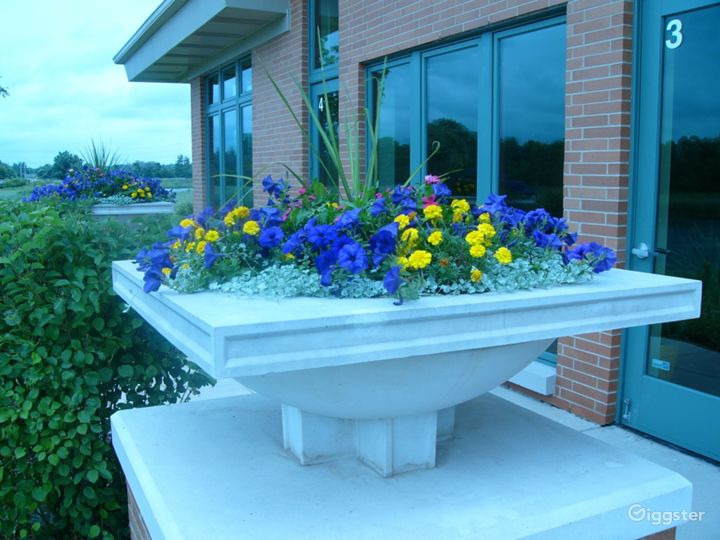 Clarus Center Entry - flowers and plantings are changed seasonally
