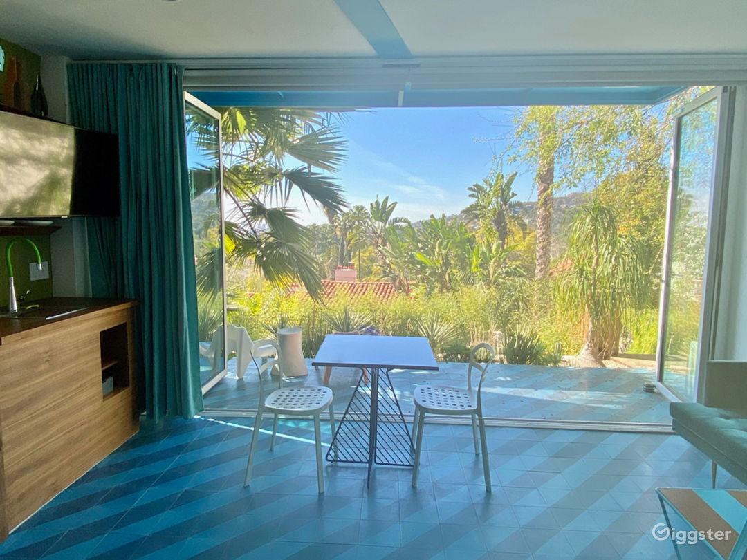 folding glass wall fully opens to terrace garden