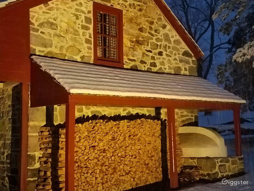 Winter evening highlighting bake oven detail.