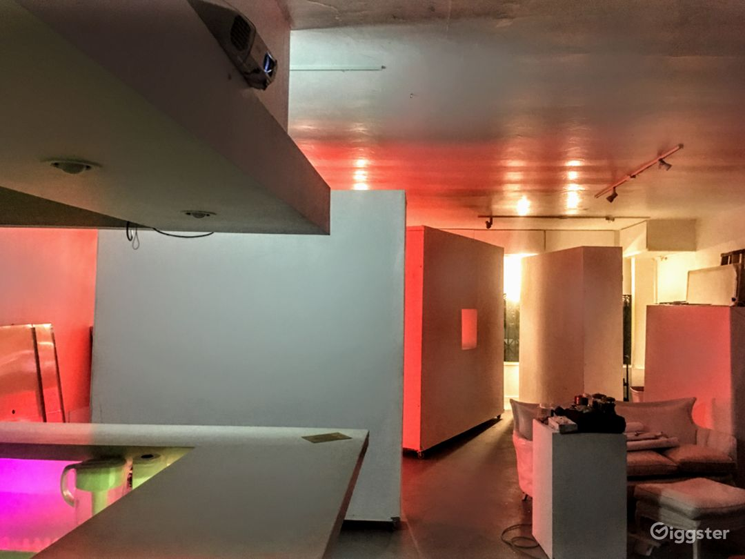Moveable white walls on wheels in Main Studio Area/Art Gallery with polished concrete floors. All furniture is movable