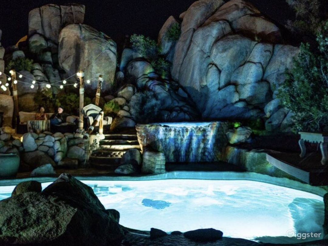 Lagoon pool with 12 man hot tub and 20 ft waterfall..