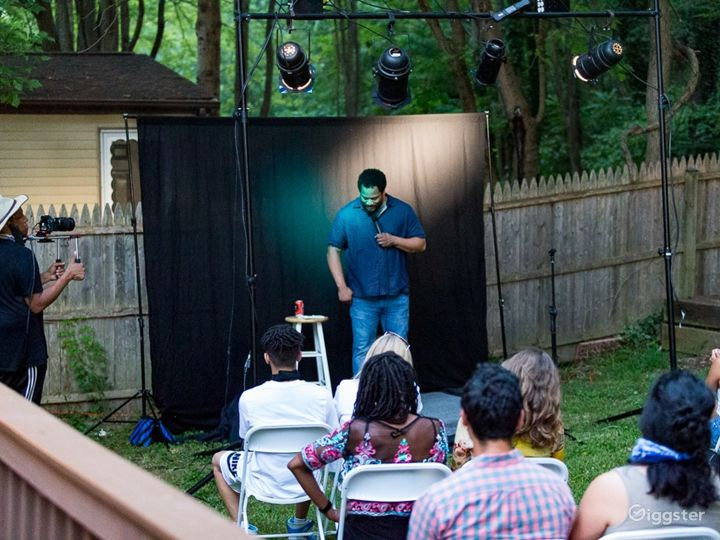 Backyard Event Space in with Stage Photo 2