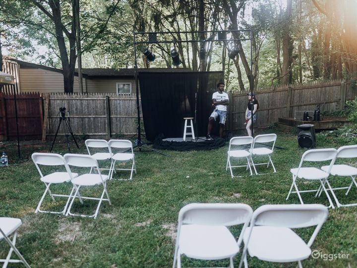 Backyard Event Space in with Stage Photo 4