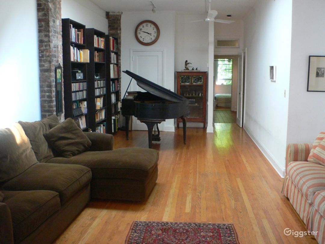 Big, open living room space with giant skylight and baby grand piano.