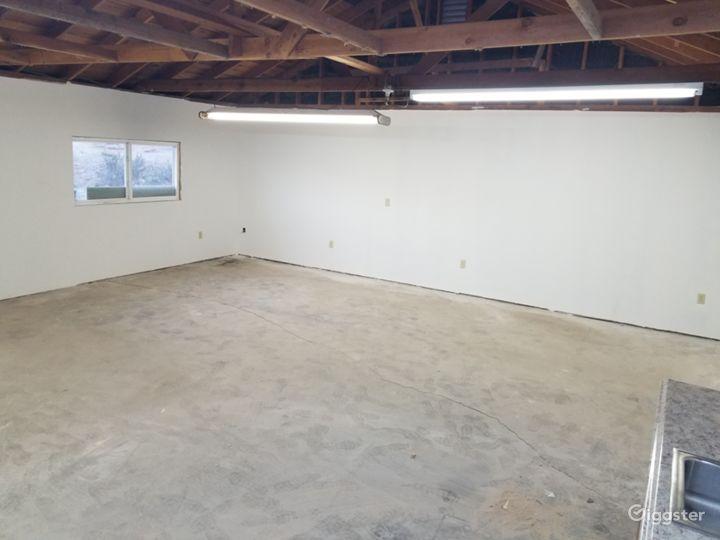 Cement floor.  Entrance access door for roll in equipment.