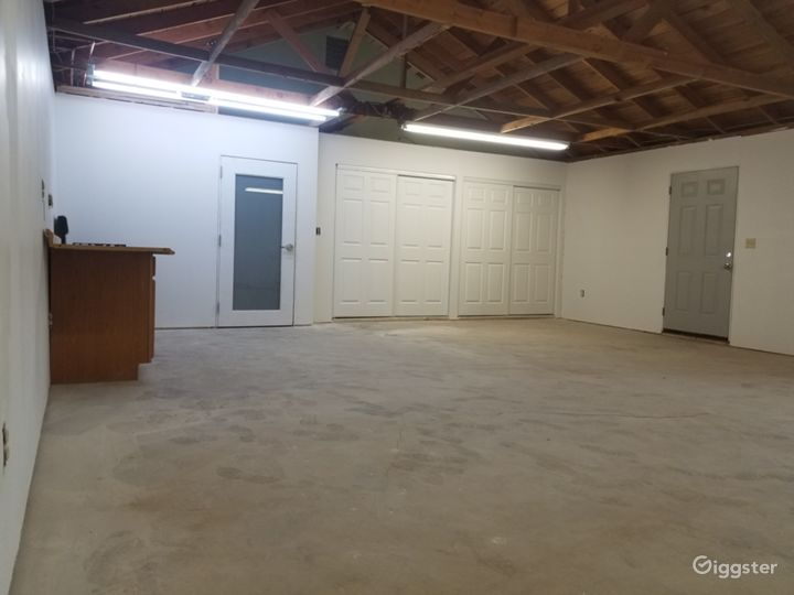 Bathroom located on other side of glass door. Large closet with 4 sliding doors.