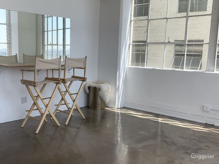 A mirror, plenty of natural light, and a built-in countertop make our hair/makeup room a favorite place to get ready.
