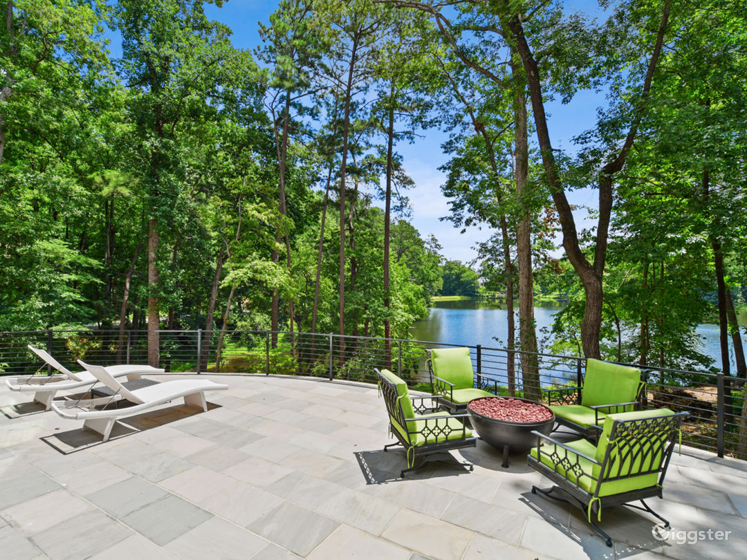 Expansive rear patio has spectacular views of lake, access to backyard and waterfront, gas fire pit,  southern exposure light