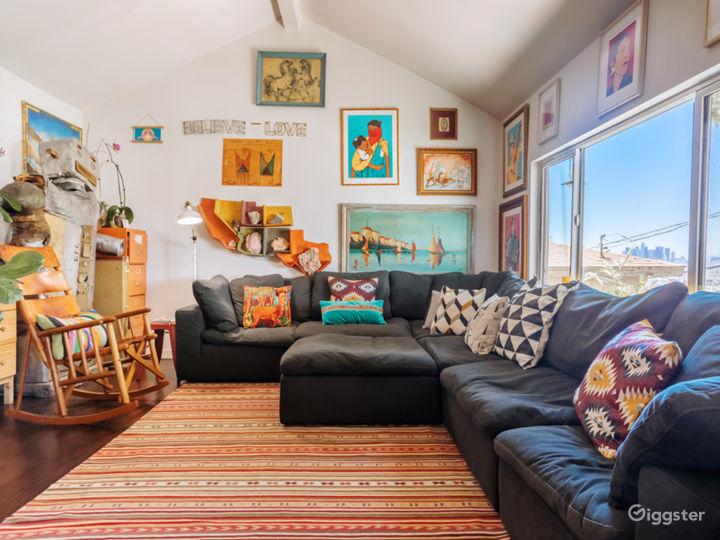 Original Art, great city view, RH Cloud couch, leather rocker.