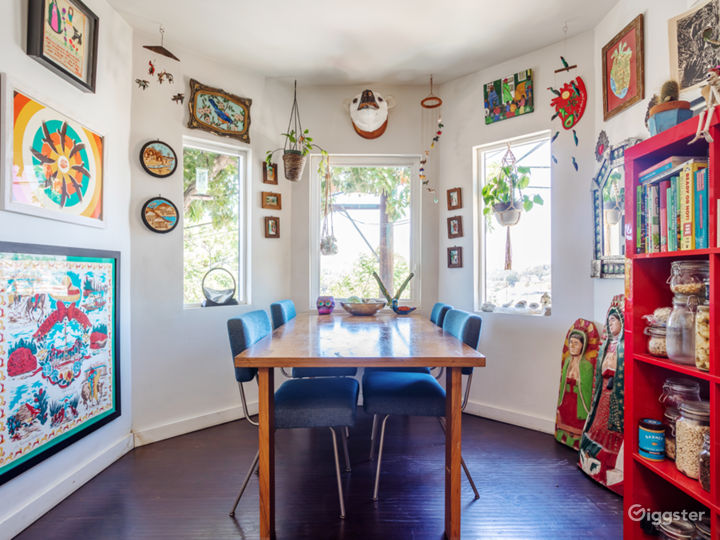 Eat in kitchen with Modernica table & chairs x 4. Original art.