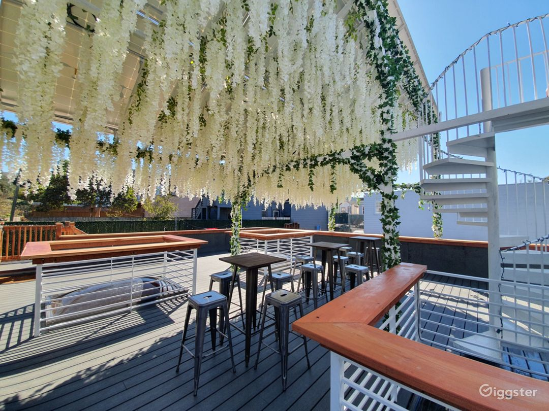 Pergola rooftop with hanging flowers