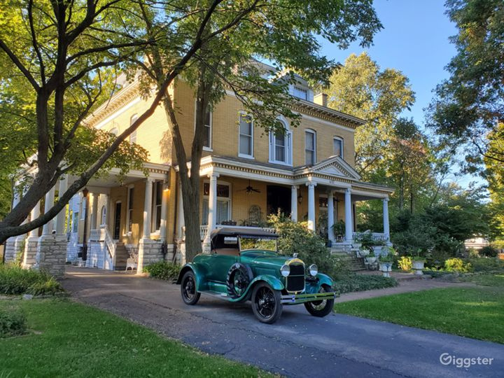 Model A Ford in the driveway of The BEALL MANSION