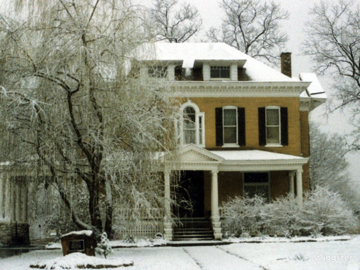 Front view of The BEALL MANSION in the snow