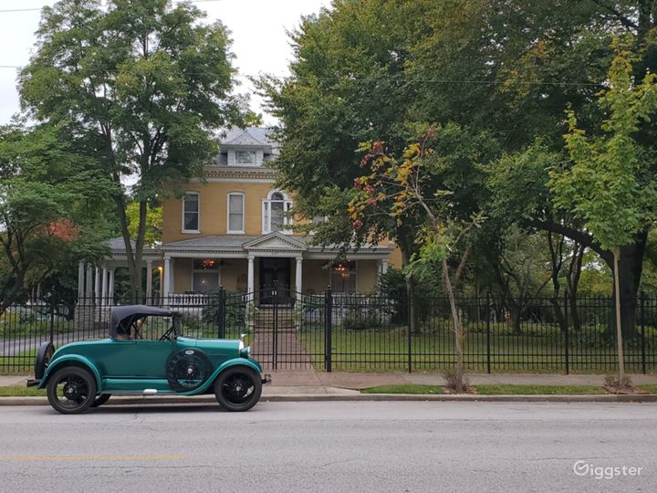 Model A Ford on East 12th Street in front of The BEALL MANSION