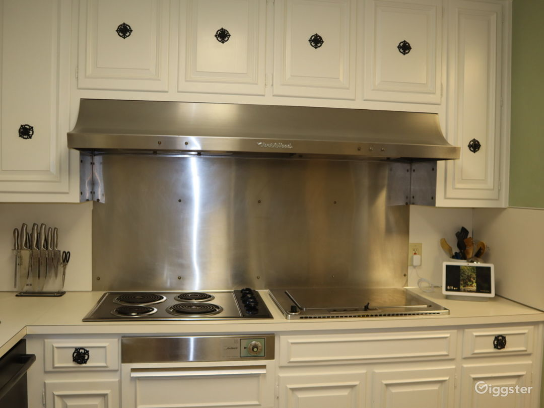 Kitchen with updated painted cabinets; original indoor grill and warming drawers