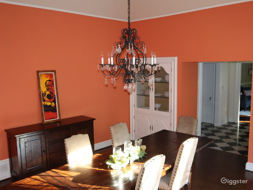Large dining room with built-ins and 1950s French chandelier