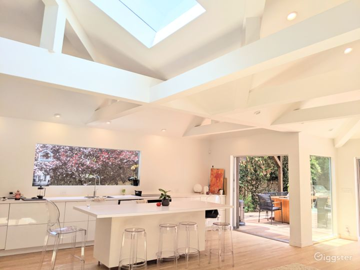 Sunlit 50's House w/open floor plan, wood floor, white walls, furnished outside area Photo 3