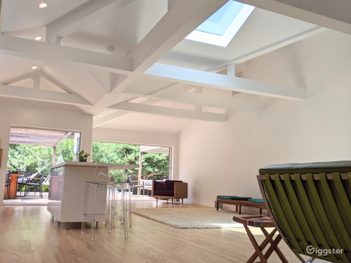 Sunlit 50's House w/open floor plan, wood floor, white walls, furnished outside area Photo 5