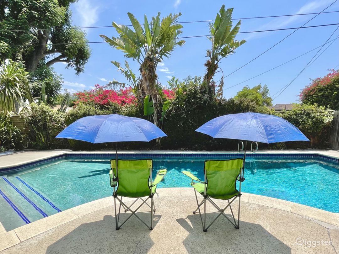 Spacious Backyard with a Splendid Pool and Patio Photo 1