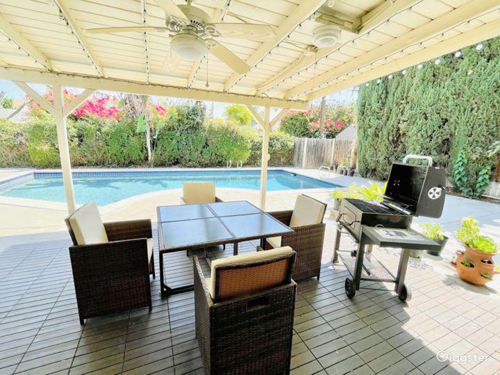 Spacious Backyard with a Splendid Pool and Patio Photo 5