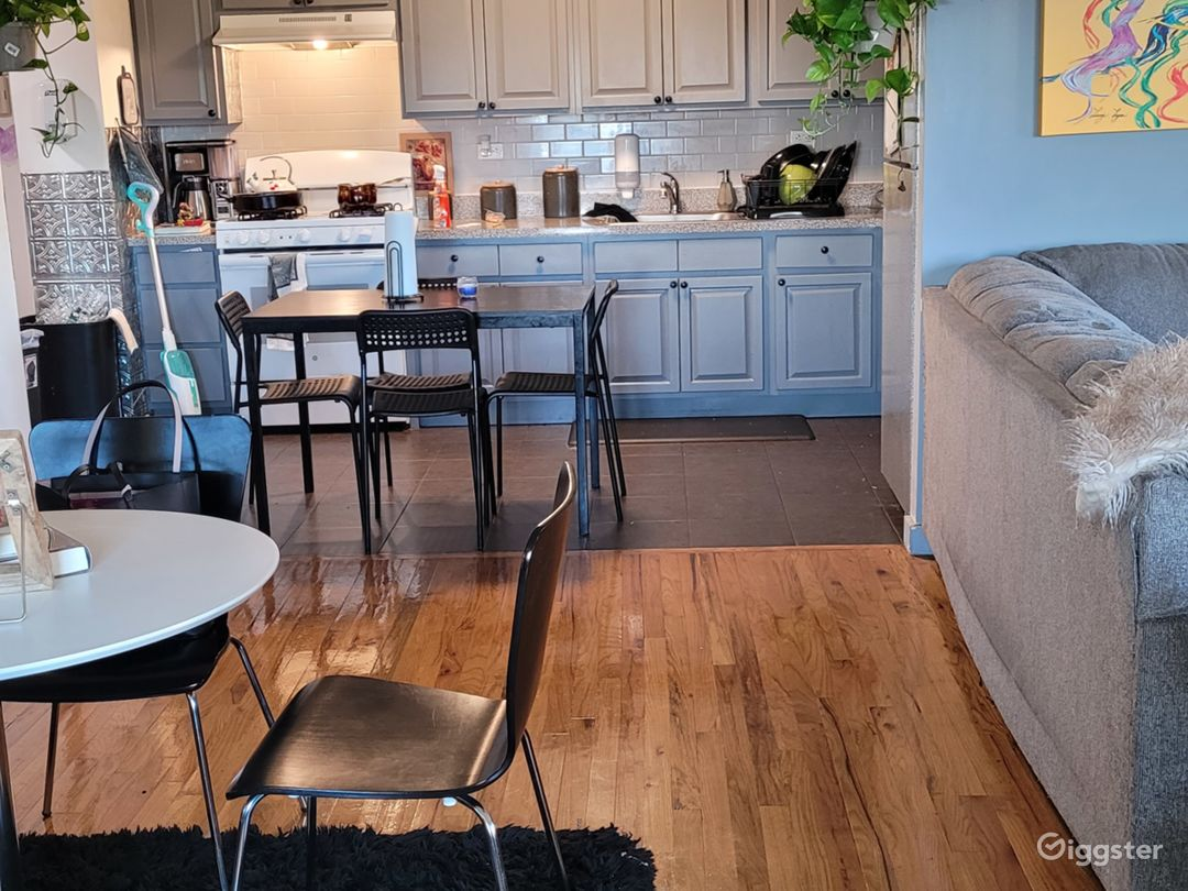 The open floor plan kitchen and partial dining room