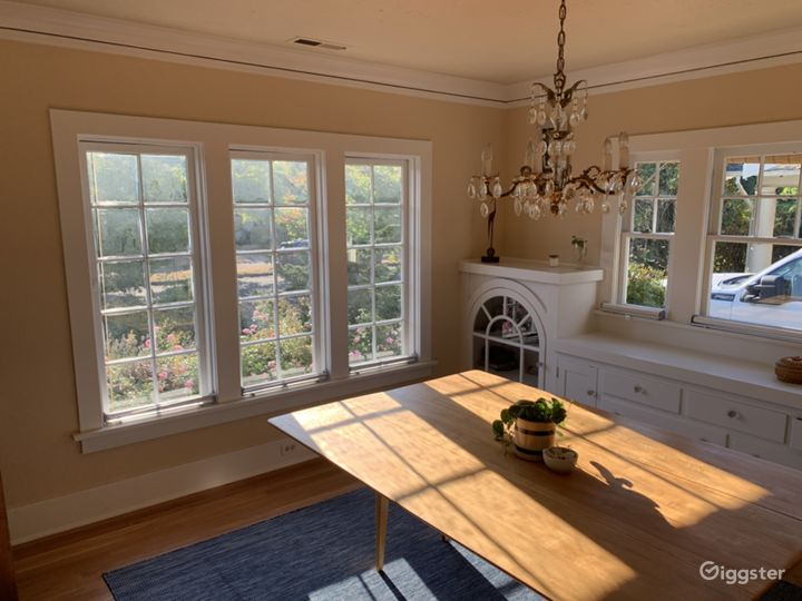 Dining room with cut glass chandelier and casement windows, built ins