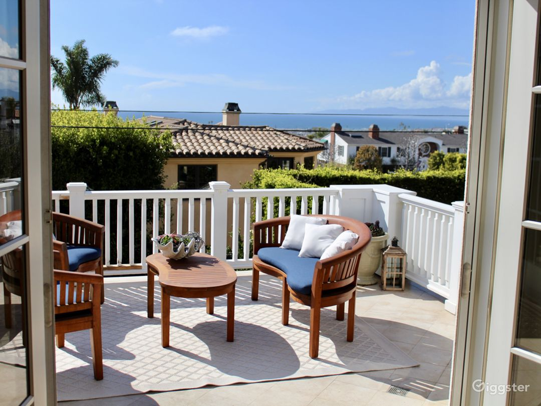 Large upstairs balcony with ocean view and view of the new pool/entertainment area downstairs.