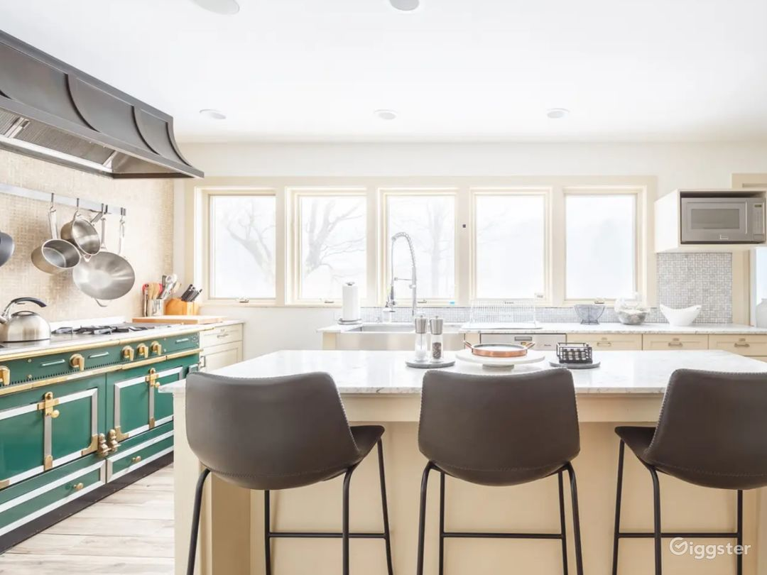 Kitchen with natural light. Island. Range. Seating.