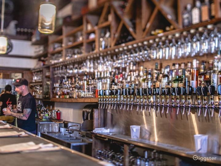 Spacious Beer Bar with Wood and Brick Features Photo 5
